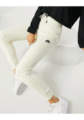 Nike essential tight fit fleece joggers in off white