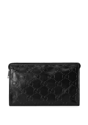 Gucci GG-embossed clutch bag - Black