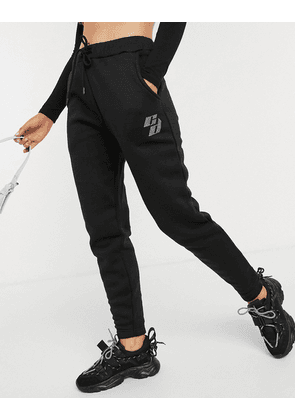Criminal Damage oversized joggers with rhinestone embellished logo in black