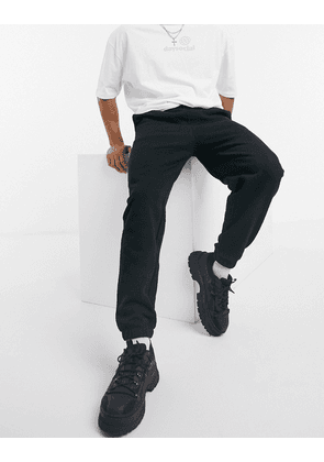ASOS DESIGN oversized joggers with narrow cuffs and waistband in black