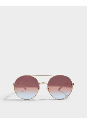 Gucci Round Shaped Sunglasses in Gold