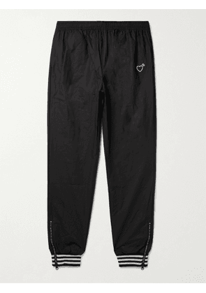 ADIDAS CONSORTIUM - Human Made Tapered Logo-Print Striped Crinkled-Shell Track Pants - Men - Black - XS