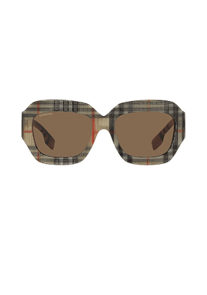 Burberry B. Check in Brown.