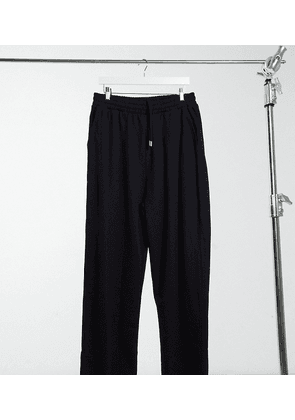 ASOS DESIGN Tall organic super oversized joggers in black with toggle hem