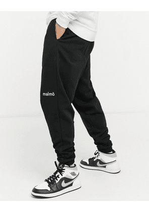 ASOS DESIGN co-ord oversized joggers with small city print in black