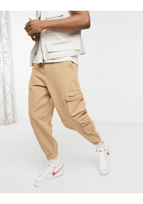ASOS DESIGN oversized tapered joggers in heavy washed canvas-Neutral