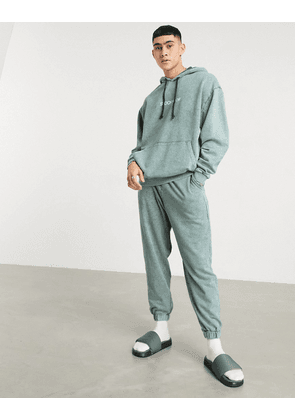 ASOS DESIGN oversized tracksuit with hoodie in vintage washed green