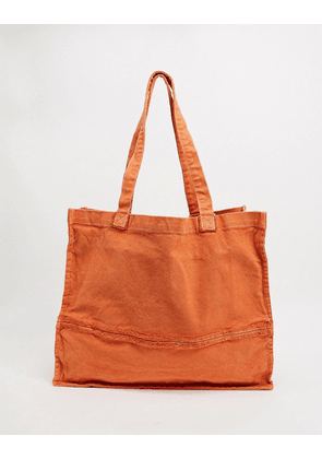 ASOS DESIGN oversized tote bag with raw edges in washed orange