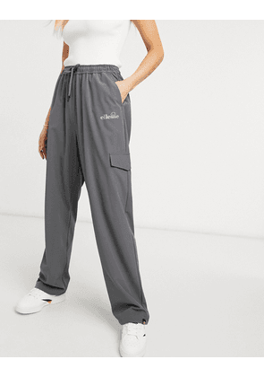 ellesse cargo pants with reflective logo in grey- exclusive to ASOS