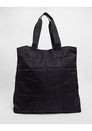 ASOS DESIGN oversized padded weekend bag in black nylon