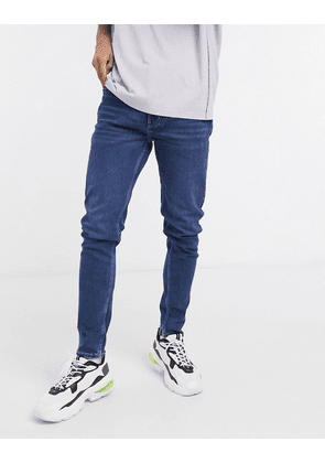 Weekday Cone tapered jeans in sway blue wash