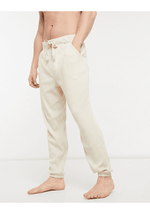 ASOS DESIGN lounge oversized joggers in ecru rib fabric-Neutral