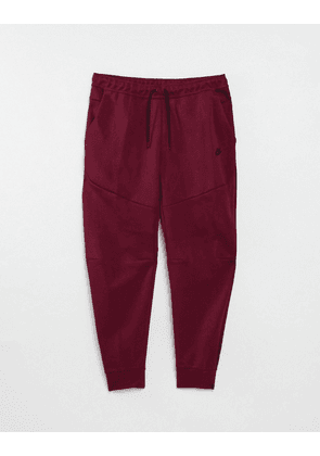 Nike Tech Fleece Essentials joggers in red