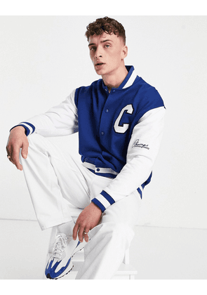 ASOS DESIGN oversized jersey varsity jacket in colour block with collegiate embroidery-Blue