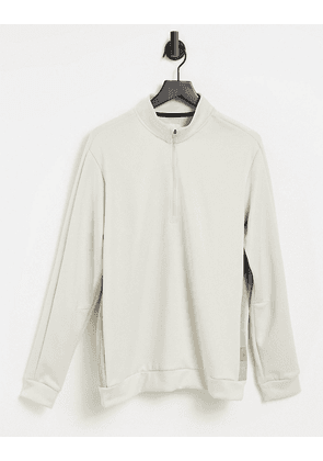 adidas Golf Adicross half zip jacket in stone-Neutral