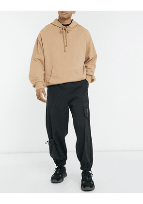ASOS DESIGN joggers with 3D pockets in black
