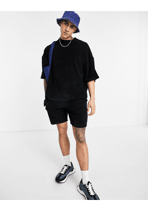 ASOS DESIGN co-ord oversized towelling shorts in black-Neutral
