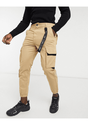 Bershka cargo trousers with chain in brown