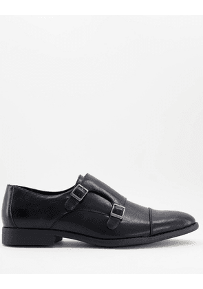 ASOS DESIGN monk shoes in black faux leather with emboss panel