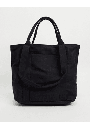 ASOS DESIGN oversized heavyweight tote bag in black organic cotton with grab and shoulder handle