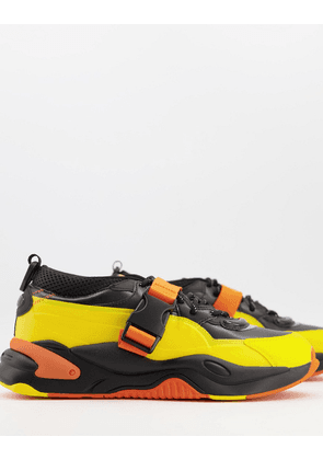 Puma x Central Saint Martins RS-2K trainers in black and yellow