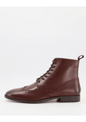 ASOS DESIGN brogue boots in brown leather with black sole