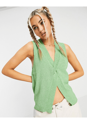 ASOS DESIGN sleeveless top with twist front detail in green
