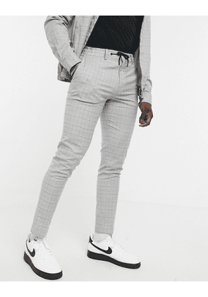 ASOS DESIGN co-ord smart skinny trousers with draw cord waist in grid check grey marl-Brown