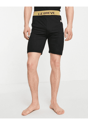 Le Breve lounge co-ord shorts in black with gold tape