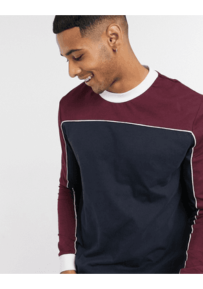 ASOS DESIGN long sleeve t-shirt with contrast yoke and woven tab-Navy
