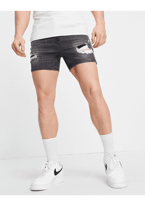 ASOS DESIGN skinny denim shorts in washed black in shorter length with heavy rips