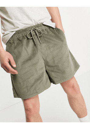 ASOS DESIGN wide fit shorts in khaki cord-Green