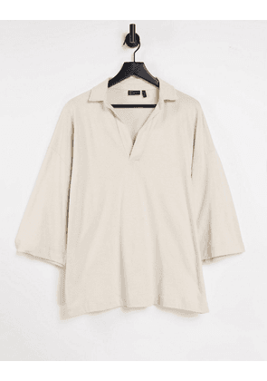 ASOS DESIGN oversized revere polo with half sleeve in beige-Neutral