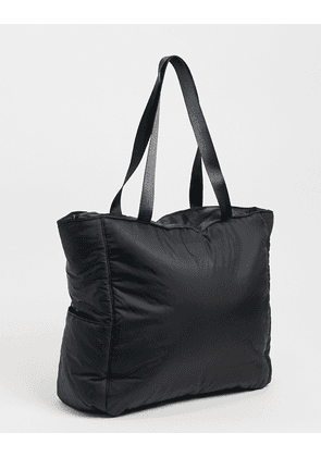 ASOS DESIGN padded tote bag in black nylon with side pockets