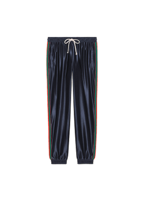 Shiny jersey trousers with Web