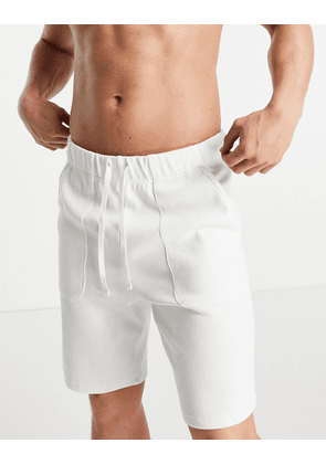 ASOS DESIGN relaxed knitted look lounge shorts in off-white