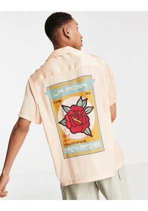 ASOS DESIGN relaxed deep revere satin shirt with rose placement print in pink