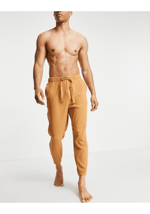 ASOS DESIGN oversized lounge ribbed joggers in brown