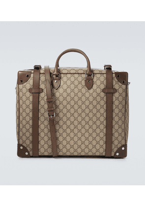 GG Supreme leather-trimmed suitcase