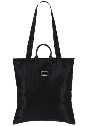 Acne Studios Awen Plaque Face Tote in Black - Black. Size all.