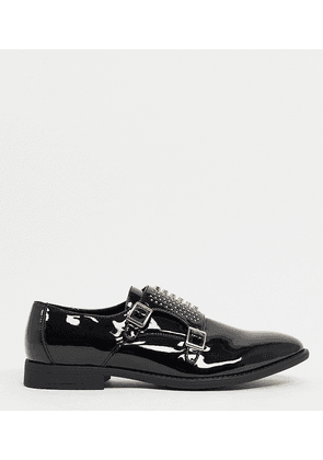 ASOS DESIGN Wide Fit monk shoes in black patent faux leather with gold studs