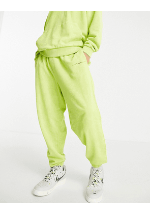 ASOS DESIGN co-ord oversized joggers in acid green vintage wash with print