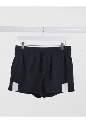 ASOS DESIGN swim shorts with cut and sew in black super short length