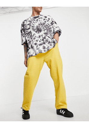 ASOS DESIGN organic oversized joggers with toggle details in yellow