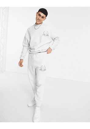 ASOS DESIGN co-ord oversized joggers with logo print in white marl