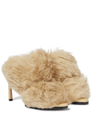 The Curve shearling sandals