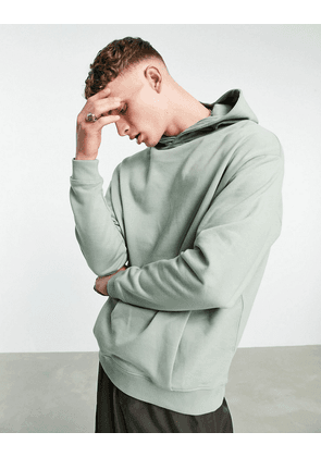 ASOS DESIGN organic co-ord oversized hoodie with crossover neck in green