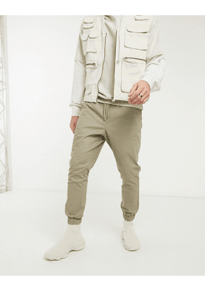 ASOS DESIGN tapered chino joggers in beige-Neutral