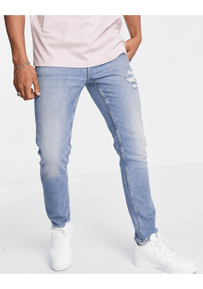 ASOS DESIGN Organic cotton blend stretch slim jeans in mid wash blue with abrasions