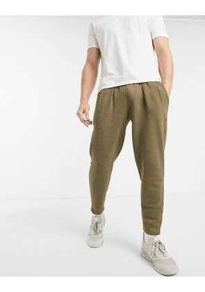 ASOS DESIGN tapered joggers with pleats in dark green marl